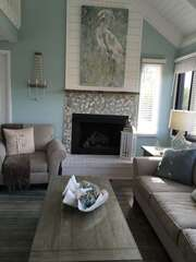 Step in the front door and be welcomed by the beautiful stone and ship lap fireplace.