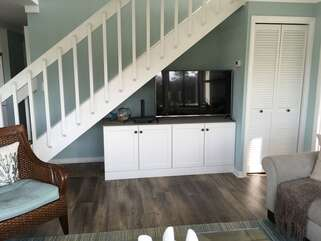 Enjoy watching cable TV on the large HDTV.  The washer and dryer is also conveniently located on the first floor.