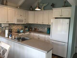 Enjoy cooking in the kitchen which is fully stocked and provides all the modern conveniences of home.