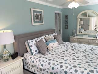 Master bedroom has a king size bed, shiplap ceilings and plenty of storage dresser space.