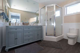 The master bathroom has a shower and double vanity