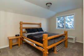 The second bedroom is on the top floor and features a log queen bed, there is also a pull out twin under the bed