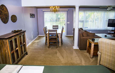 Large dining room table with seating for six