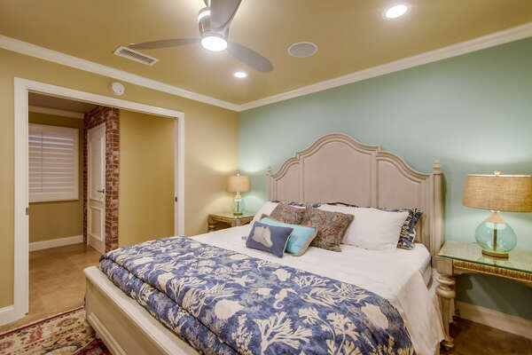 First Floor Bedroom with Pocket Doors and a King Bed