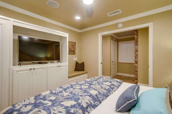 First floor bedroom with pocket doors, king bed