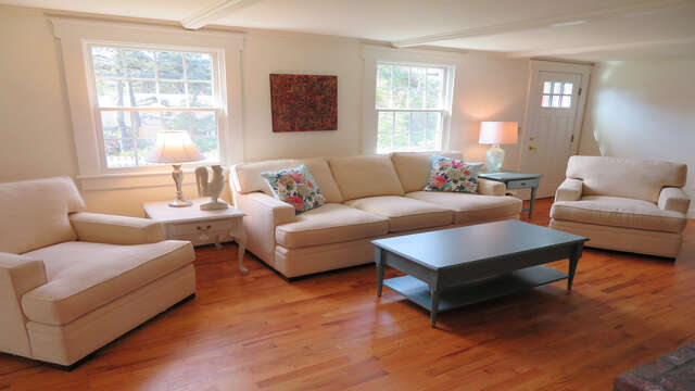 Living room with comfy furnishings. There is central air throughout - 142 George Ryder Road S Chatham Cape Cod - New England Vacation Rentals