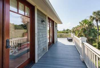The wrap around deck on the second level provides panoramic views and an incredible view of Seabrook sunsets.