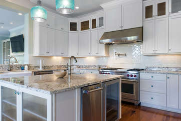 The fully stocked chef's dream kitchen features a 48