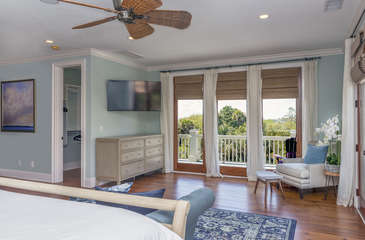 The serene master suite is on the second floor. Doors lead out onto the second floor wrap around deck.