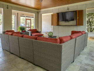 The lower level screened in lanai is waiting to meet all your entertainment needs, a perfect gathering spot with large HDTV, ping pong table, and bar.