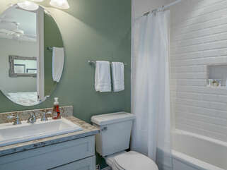 The private bath has a granite vanity and tub/shower combo.
