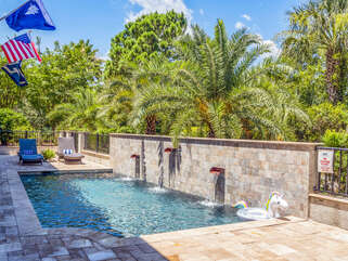 You will want to spend your days on the lower level with a fully screened lanai adjacent to the pool deck. The screens roll up to enlarge this space.