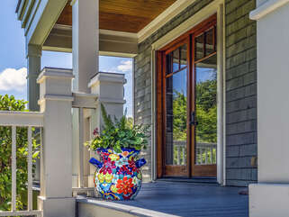 The majestic second level entrance will captivate you. Pick a spot on the multi level wrap around porch to take in the abundant plants and trees that create your own private resort.