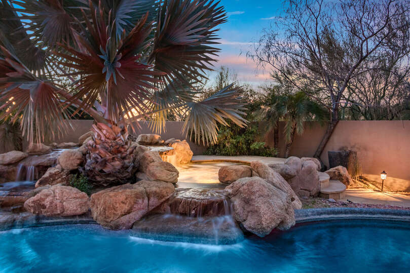 Lighted spa with water feature and Mexican Palm Tree.