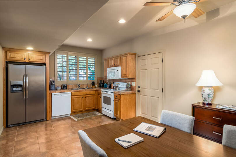 Full kitchen with dining area.