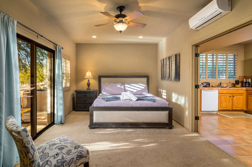 Casita Bedroom with View into Kitchen Separated by Windowed French Doors