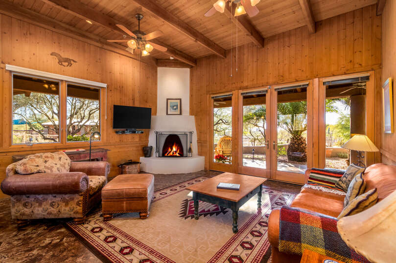 Views Across Cabin Living Area to Adobe Fireplace and Outdoors