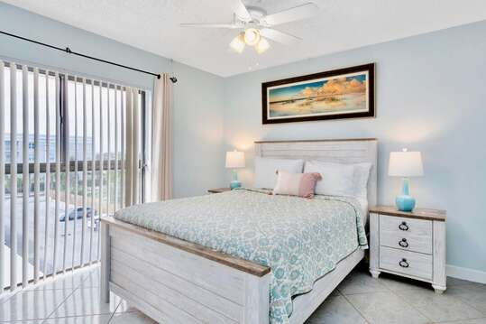Guest bedroom with a queen bed and TV