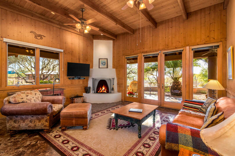 Cabin living area with fireplace and patio.