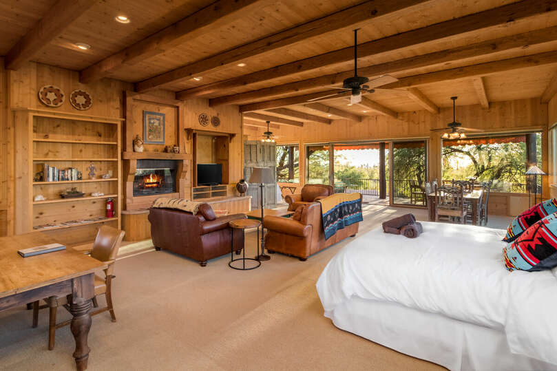 Loft with two beds, seating, fireplace, and full kitchen.