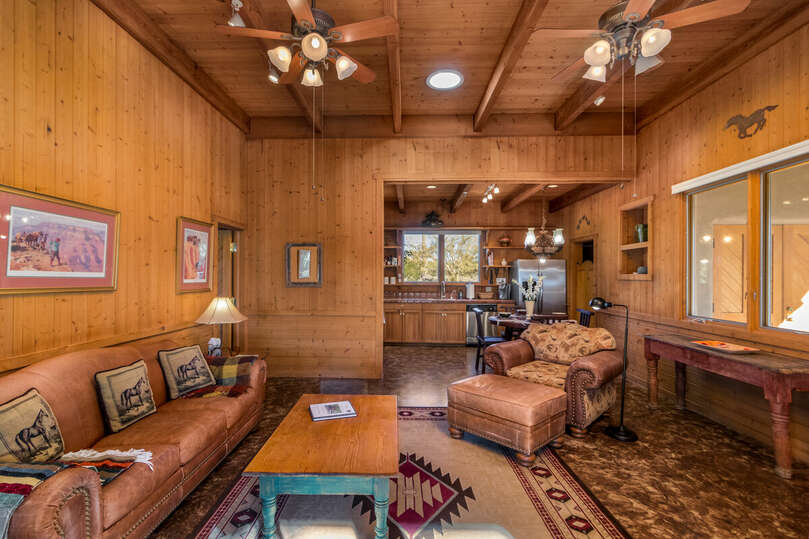 Cabin living area with full kitchen and adobe fireplace