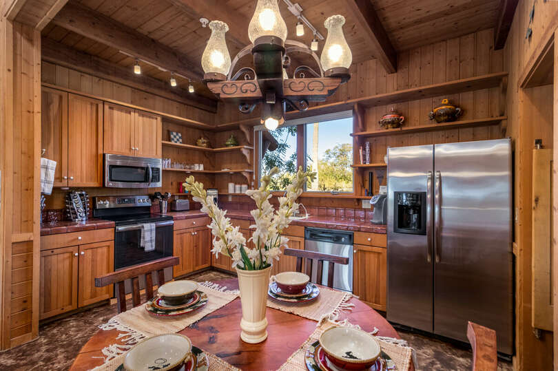 Cabin full kitchen with dining table