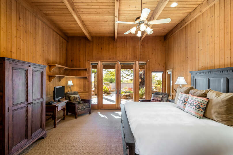 Cabin bedroom with view of the beautiful front yard
