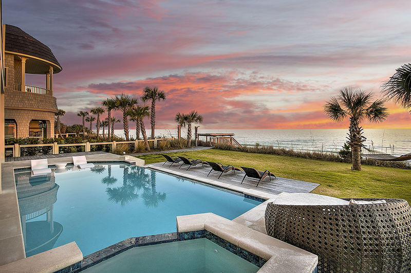 Pool in the backyard of this Luxury Vacation Rentals Destin
