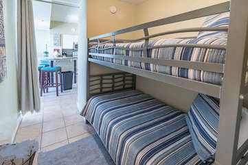 Bunk bed area with curtain partician