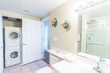 Bathroom adjacent to Queen bedroom with washer and dryer