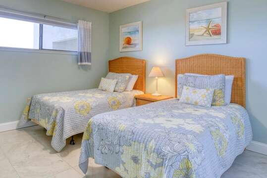 Guest bedroom with twin beds and TV