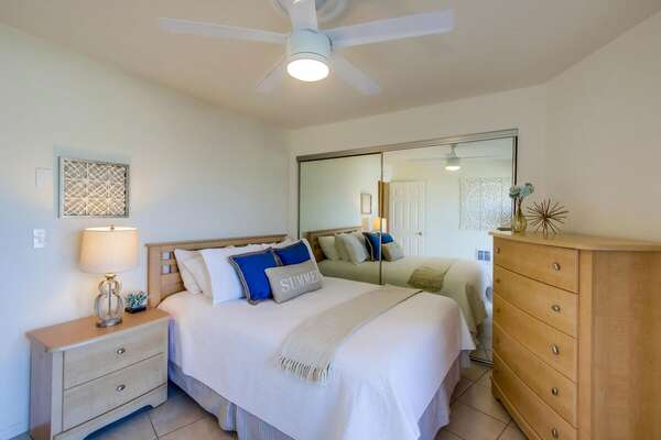 Large Bed, Dresser, Mirror Closet Doors, Nightstand, and Ceiling Fan.