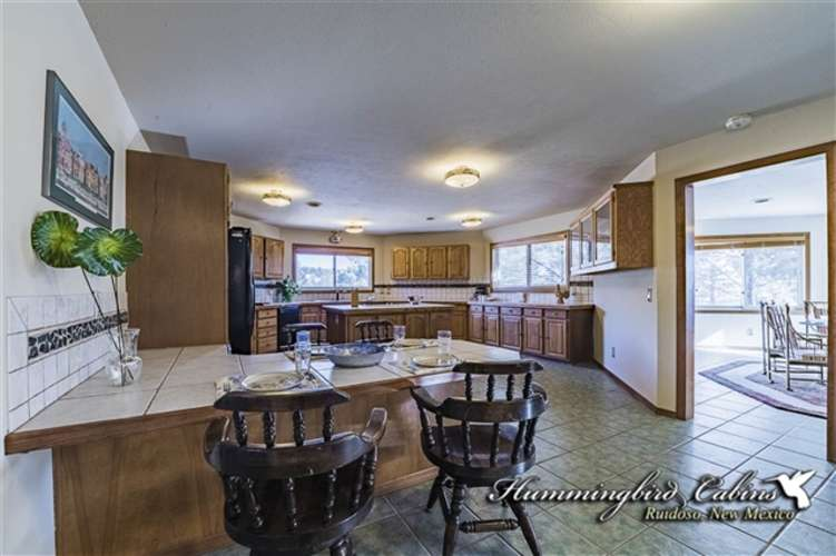 Over sized kitchen with a breakfast bar