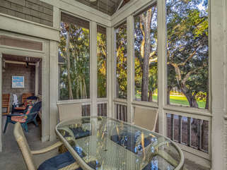 Over sized screen porch with plenty of seating