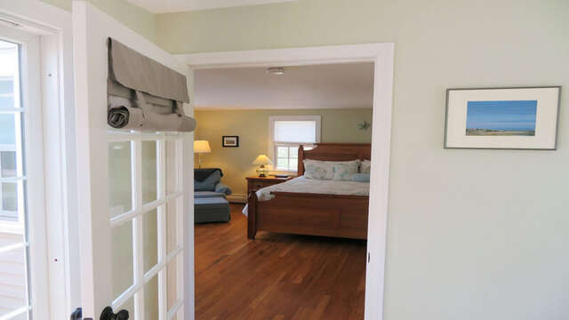 Through the sunroom, to access the master bedroom - 33 Pine Grove West Harwich Cape Cod -  New England Vacation Rentals