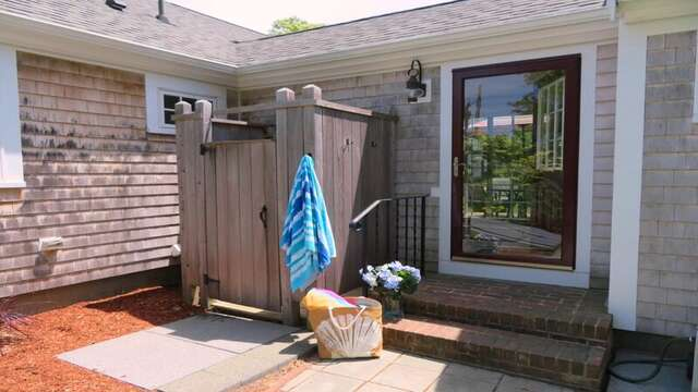 Enclosed outdoor shower with hot and cold water just off of the sunroom - 33 Pine Grove West Harwich Cape Cod -  New England Vacation Rentals