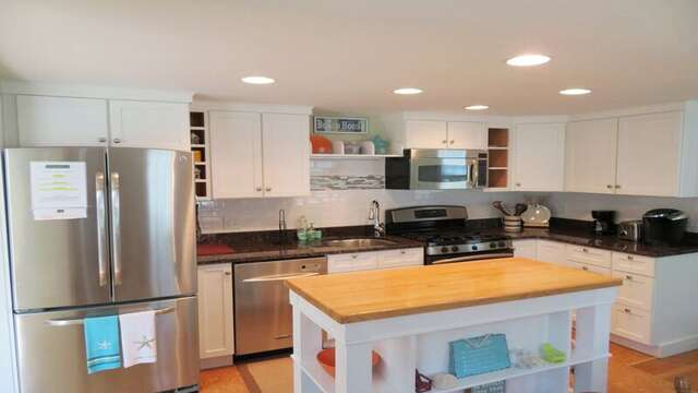 All stainless appliances and a center island - 33 Pine Grove West Harwich Cape Cod -  New England Vacation Rentals