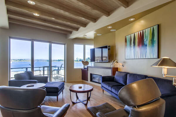 2nd floor living room, flat screen TV, fireplace and bay views