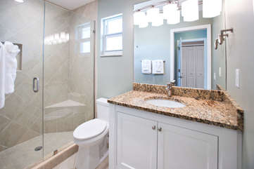 the master bath featuring granite countertops and grohe fixtures.