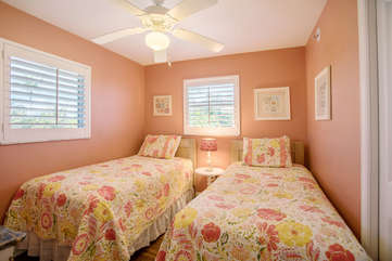 the third guest room featuring two twin beds and coastal decor.
