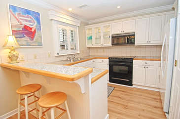 The kitchen is roomy and modern with a breakfast bar.