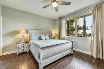 Vibrant master bedroom with king size bed and gorgeous views of pool deck area