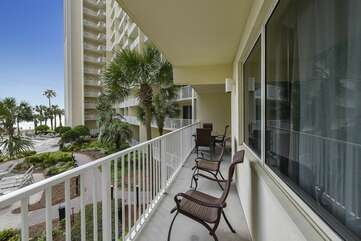 Balcony area includes patio furniture for some relaxing R&R with gorgeous pool deck views
