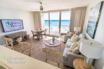 This living room has spectacular views looking out unto the Gulf of Mexico right from the living room space.