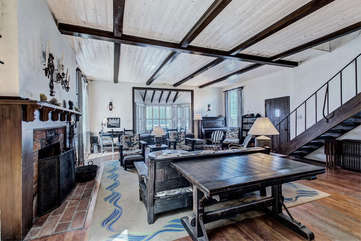 Spacious living with two dining tables.