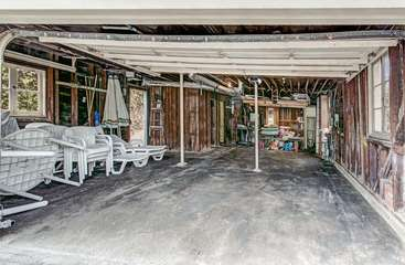Garage with all patio furniture, BBQ, boogie boards, beach chairs and sand toys