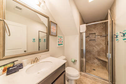 Full bath with walk in tiled shower
