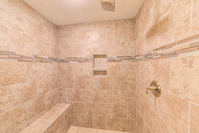HUGE walk in shower with bench
