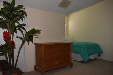 Loft Bedroom with Dresser and Tropical Plant