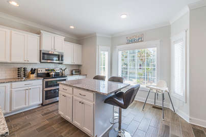 Open kitchen with a double oven